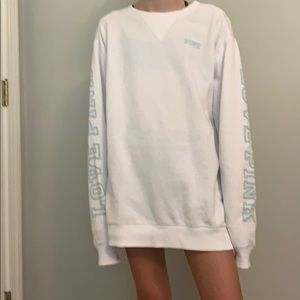 white and teal pink brand sweatshirt